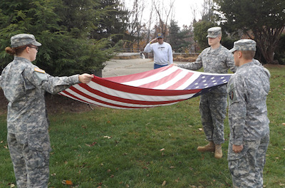 Photo Caption: Picture left to right, SCCC students; Melissa Landtau, U.S. Army National Guard, Andrew Perrier, U.S. Army Reserves and Corey Murphy, U.S. Army Reserves. Saluting the flag is Navy Veteran, James Cahill. Photo courtesy of Sussex County Community College.