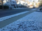 Snow dusted along the front yards of Trinity Street in Newton. Photo by Jennifer Jean Miller.