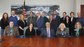 SCCC President, Dr Paul Mazur (Center), is seated amongst the administration, faculty and staff of both Berkeley College and Sussex County Community College for the signing of an articulation between both colleges. The signing took place in the board room at SCCC on Thursday, December 4. Photo courtesy of SCCC.