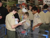 Members of Boy Scout Troop 150 shopping for their Adopt-a-Family program. Photo courtesy of Boy Scout Troop 150.
