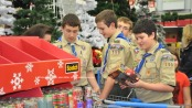Scouts from Boy Scout Troop 150 inspect gift items they purchased. Photo by Jennifer Jean Miller.