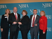The New Jersey Business and Industry Association presents New Jersey Labor Commissioner Harold Wirths and State Senator Fred Madden with the Paul Troast Award, which is presented annually to a public servant who has made an outstanding contribution to the State of New Jersey and its business community. Pictured left to right: Michele Siekerka, NJBIA President; State Senator Fred Madden; Melanie Willoughby, NJBIA Senior Vice President of Government Affairs; Labor Commissioner Harold Wirths; and Lt. Governor Kim Guadagno. Photo courtesy of the New Jersey Department of Labor and Workforce Development.