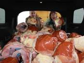 Labor Commissioner Harold J. Wirths and his wife, Debbie, load 125 Christmas hams outside the Weis Supermarket in Franklin, Sussex County, for packaging with other goods and gifts for needy families. Photo courtesy of New Jersey Department of Labor and Workforce Development.