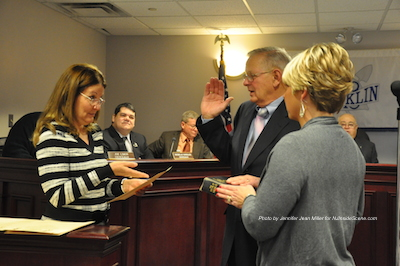 Councilman Robert Dabinett being sworn in. Photo by Jennifer Jean Miller.