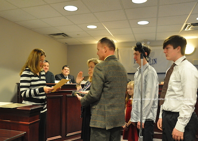Alison Littell McHose surrounded by her family during the swearing in. Photo by Jennifer Jean Miller.