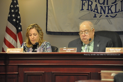 Alison Littell McHose (left) takes her seat next to Franklin Mayor Paul Crowley. Photo by Jennifer Jean Miller.