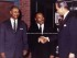 Dr. Martin Luther King Jr. in this stunning color photo, courtesy of the Drew University Library Archive. To his left is Dr. George Kelsey, who had been his mentor and a professor, and was then a professor at Drew. To his right, is Drew University President Robert F. Oxnam. Behind Dr. King is an assortment of items behind glass in tribute to him.
