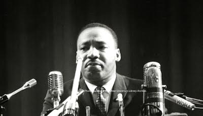 Dr. Martin Luther King Jr. at the microphone. The microphone to the far right has a sticker for WDHA on it, still a radio station in the area today. Photo courtesy of the Drew University Library Archive.