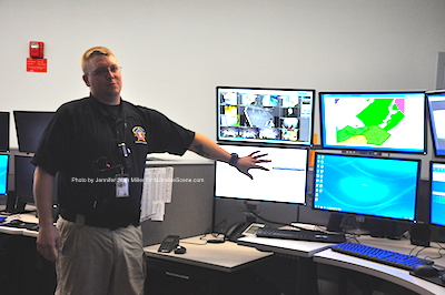 Dave Corver of the Sussex County Sheriff's Office explains the systems to visitors. Photo by Jennifer Jean Miller.