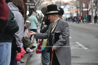 Newton's Town Crier, William Joseph, passes out gold coins to children watching the parade. Photo by Jennifer Jean Miller.