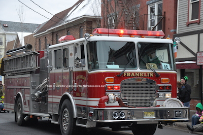 Franklin Fire Department's Truck with lights and sirens blaring. Photo by Jennifer Jean Miller.