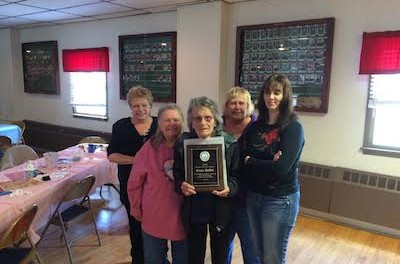 Irene Sallai (center) with her award. Image courtesy of Nick Giordano.