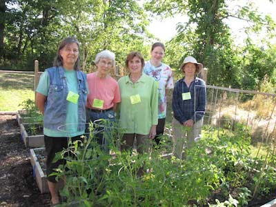Volunteers maintain the community gardens at Project Self-Sufficiency. Image courtesy of Project Self-Sufficiency.