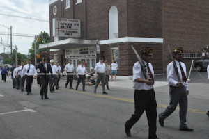 Veterans proceed down Spring Street. Photo by Jennifer Jean Miller.