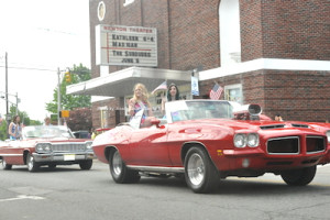 Beauty queens enjoy a jaunt down Spring Street in classic cars. Photo by Jennifer Jean Miller.