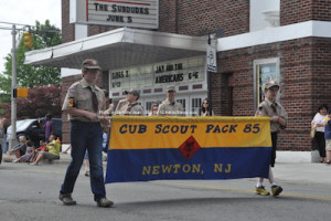 Scouts carry their banner. Photo by Jennifer Jean Miller.