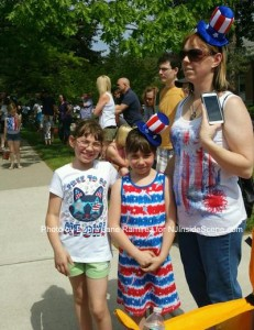 A family from Hopatcong enjoys the parade. Photo by Debra Jane Ramirez.