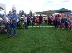 Crowds mingle while checking out the games and activities. Photo by Jennifer Jean Miller.