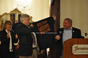 Freeholder George Graham holds up the shirt that Carl Lazzaro presented to him as Gail Phoebus looks on. Photo by Jennifer Jean Miller.