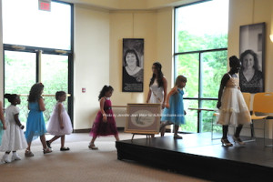 Little Miss Newton Contestants are led to the stage. Photo by Jennifer Jean Miller.
