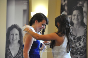 Miss Newton 2014 Emilie Petry (right) places the sash on Miss Newton 2015 Amelia Macchietto. Photo by Jennifer Jean Miller.
