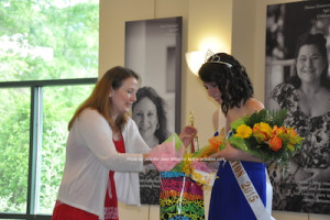Amelia Macchietto receives her crown and gifts, along with the title of Miss Newton 2015. Photo by Jennifer Jean Miller.