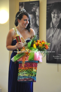 Amelia Macchietto holds all of her winnings after being crowned Miss Newton 2015. Photo by Jennifer Jean Miller.