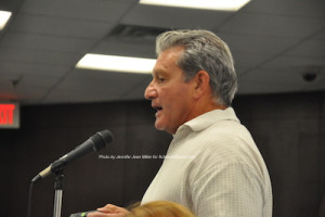 Business owner Rick Bitondo asks questions about the construction. Photo by Jennifer Jean Miller.