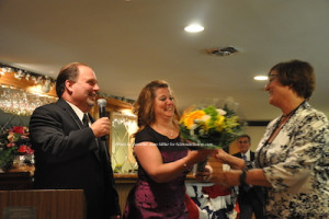 Marion Curcio is presented with a bouquet. Photo by Jennifer Jean Miller.