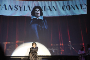 """The Rocky Horror Picture Show"" with Dr. Frank-N-Furter onstage and on the screen at The Newton Theatre. Photo by Jennifer Jean Miller."