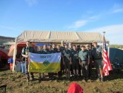 The group poses at their campsite with West Point Cadet Mitchell Valenza. Image courtesy of Venturing Crew 276.