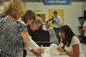 Acting chair Jill Space guides members through the voting process. Photo by Jennifer Jean Miller.