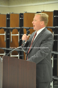 Jerry Scanlan at the podium. Photo by Jennifer Jean Miller.