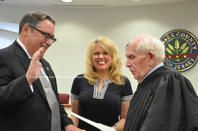 John D. Williams is sworn in as Sussex County's Counsel by the Honorable Judge Frederic Weber. Heidi Weber holds the Bible for Williams. Photo by Jennifer Jean Miller.
