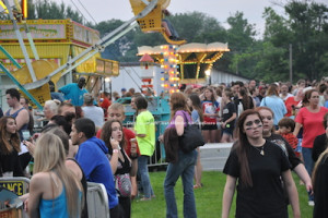 Attendees wait to enjoy rides and take in the fun offerings. Photo by Jennifer Jean Miller.