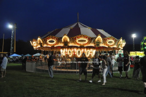 The lights twinkle on the carnival's carousel. Photo by Jennifer Jean Miller.