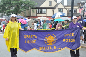 Sparta Elks carrying the banner leading the Fourth of July Parade. Photo by Jennifer Jean Miller.