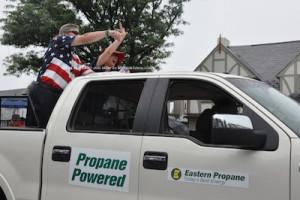 Grand Marshal Bill Curcio waves to spectators. Photo by Jennifer Jean Miller.