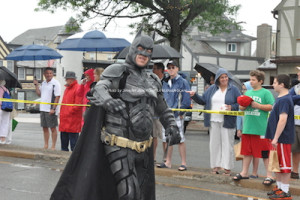 Batman making his way through the parade. Photo by Jennifer Jean Miller.