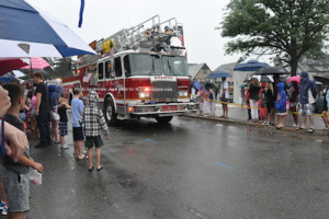 One of Sparta's engines in the parade, lights shining and sirens blaring. Photo by Jennifer Jean Miller.