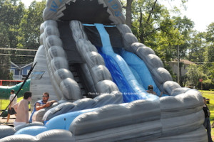 A child cools off on the water slide. Photo by Jennifer Jean Miller.