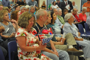 Ailish Hambel who stepped down as chair on June 10 eyes up flowers that were presented to her for her service. Photo by Jennifer Jean Miller.