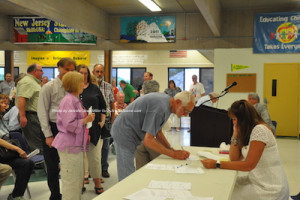 Members lining up to vote for the new chair. Photo by Jennifer Jean Miller.
