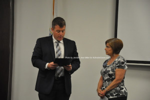 Mayor Dan Flynn presents the proclamation to MaryLou Schnurr of NORWESCAP. Photo by Jennifer Jean Miller.