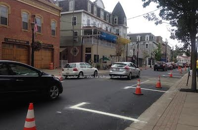 Crews just painted lines along both sides of Spring Street for parking spots. Photo by Jennifer Jean Miller.