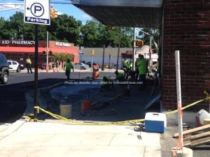 Crews smooth out the concrete on the bump outs on Spring Street. Photo by Jennifer Jean Miller.