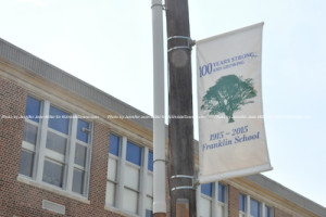 Banners commemorating the celebration in front of the school. Photo by Jennifer Jean Miller.