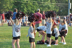 Cheerleaders take to the field. Photo by Jennifer Jean Miller.