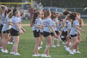 Cheerleaders add spirit to the festivities. Photo by Jennifer Jean Miller.