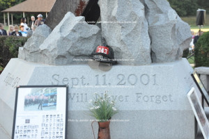 A helmet atop the memorial in honor of the victims. Photo by Jennifer Jean Miller.